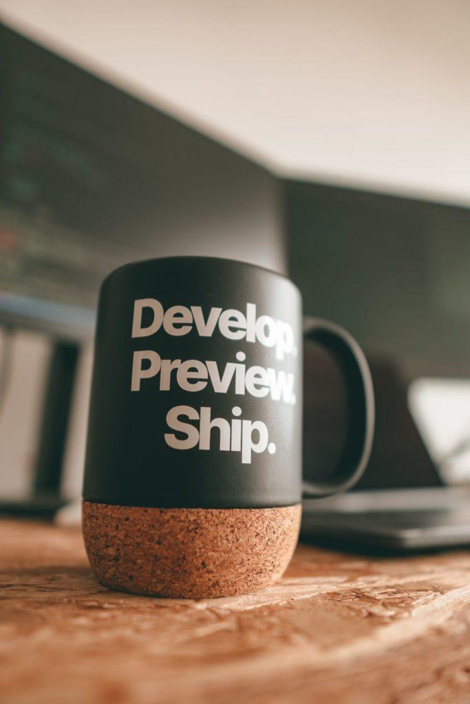 develop, preview, ship coffee mug
